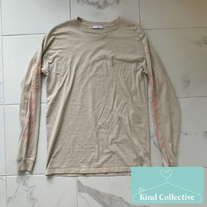 Aritzia TNA Tour Long Sleeve Beige Graphic Top